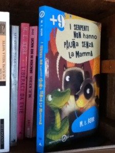 Italian Snakes Don't Miss Their Mothers and other Kerr book spines.